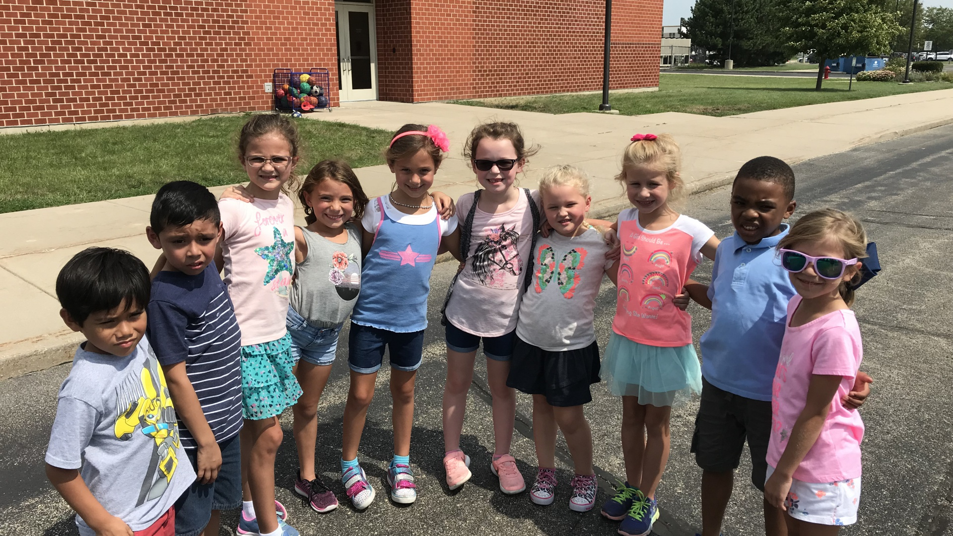 First grade students enjoying recess