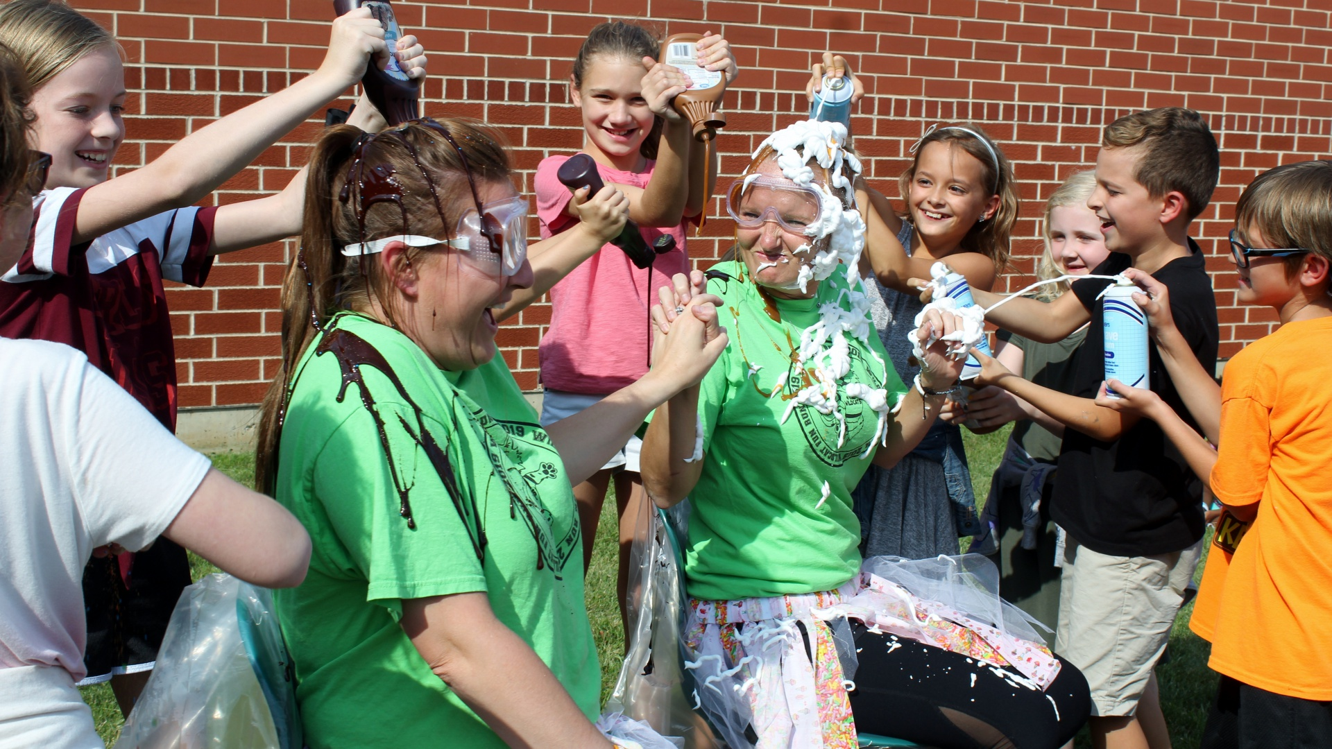 Principal Hennegan, Assistant Principal Gregoire become human sundaes for Boosterthon reward